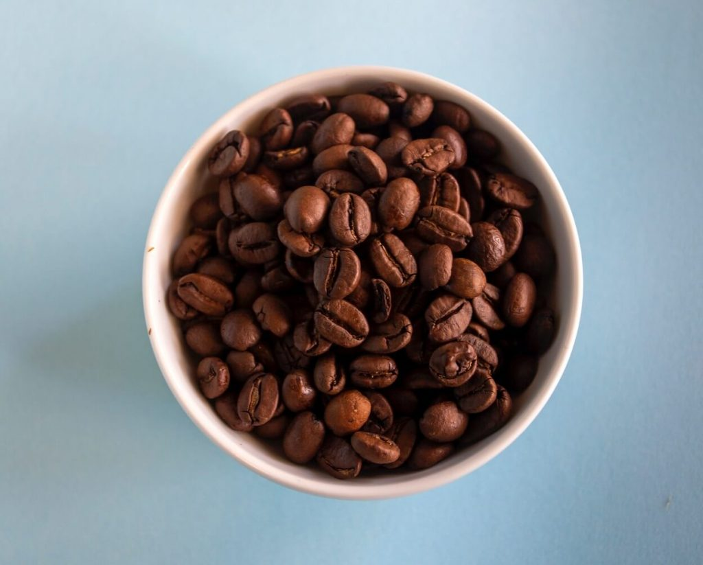 Top view of a bowl of coffee beans.