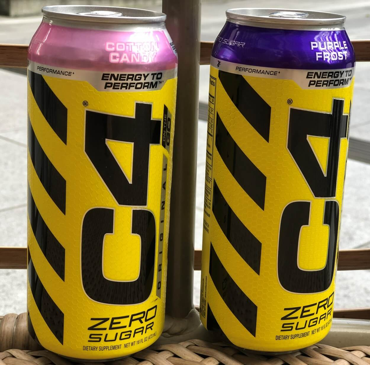 Two cans of C4 Energy drinks beside each other.