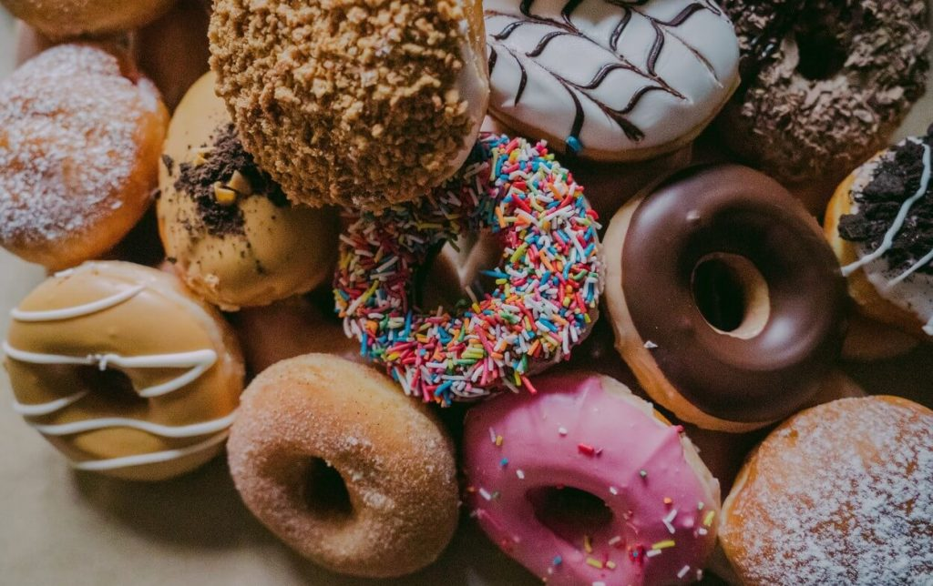 Doughnuts piled together.