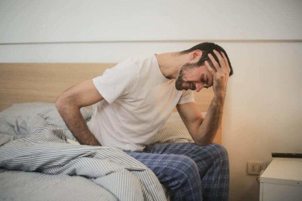 A man suffering through headache.