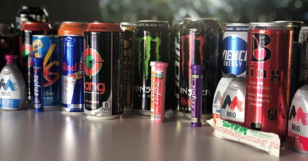 A wide array of energy drinks on the table.