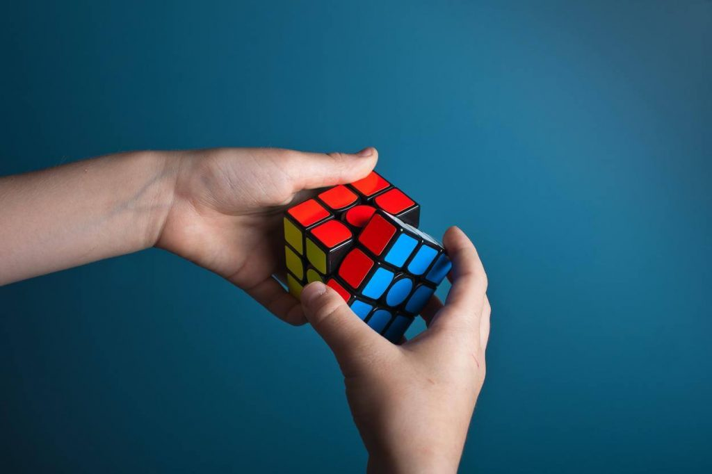 A picture of a person playing magic cube