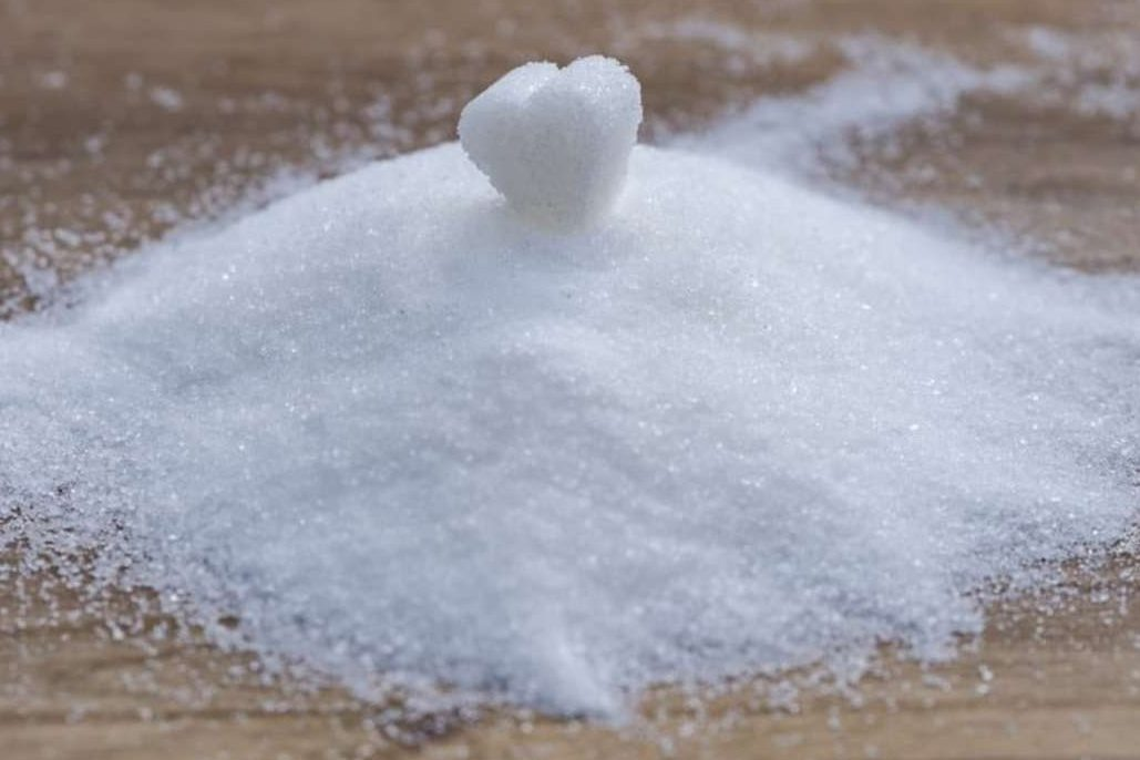 A pile of sugar with a heart.