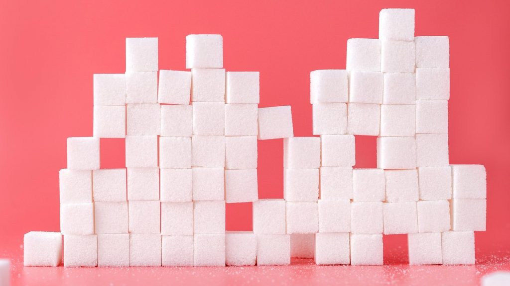 Sugar cubes piled into a tower.