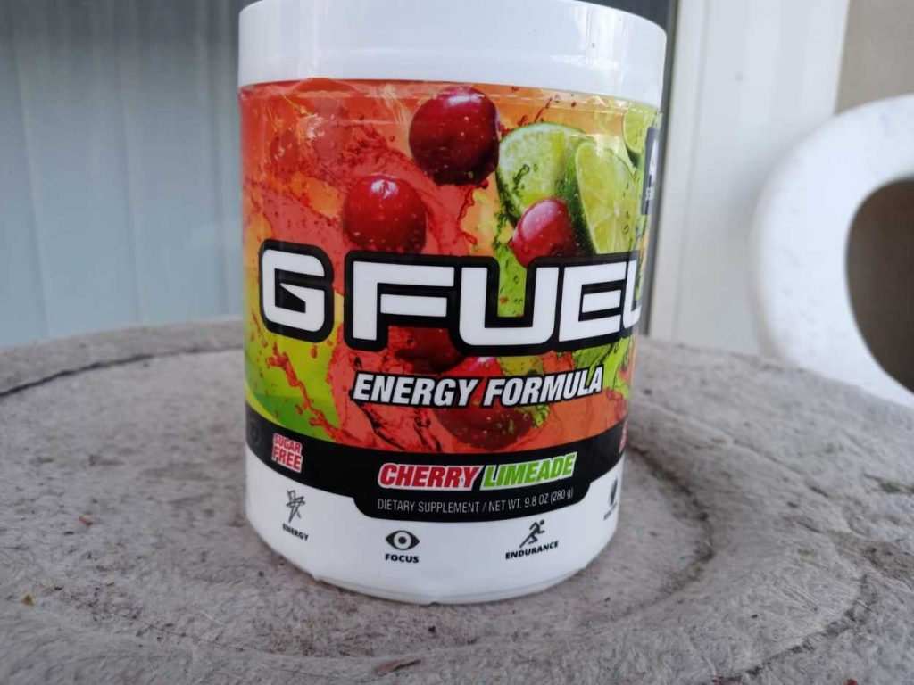 A tub of G Fuel on a table in full view.