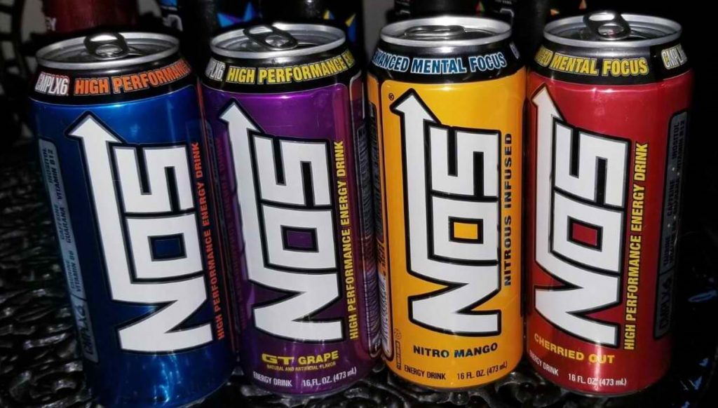 4 cans of NOS energy drink of different colors.
