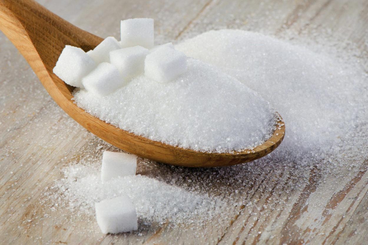 Sugar in a spoon.