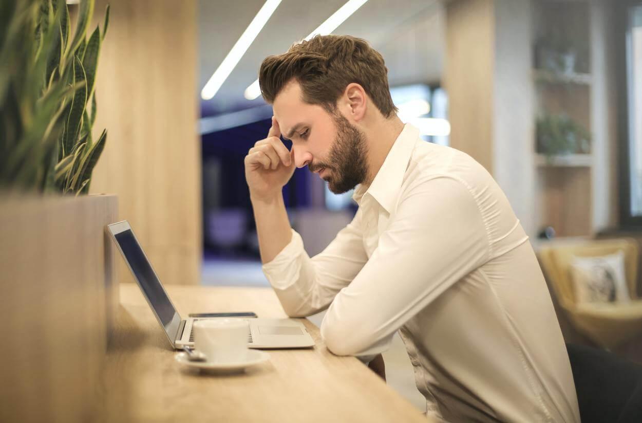 A man having a headache.