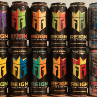 Reign energy drink cans stacked