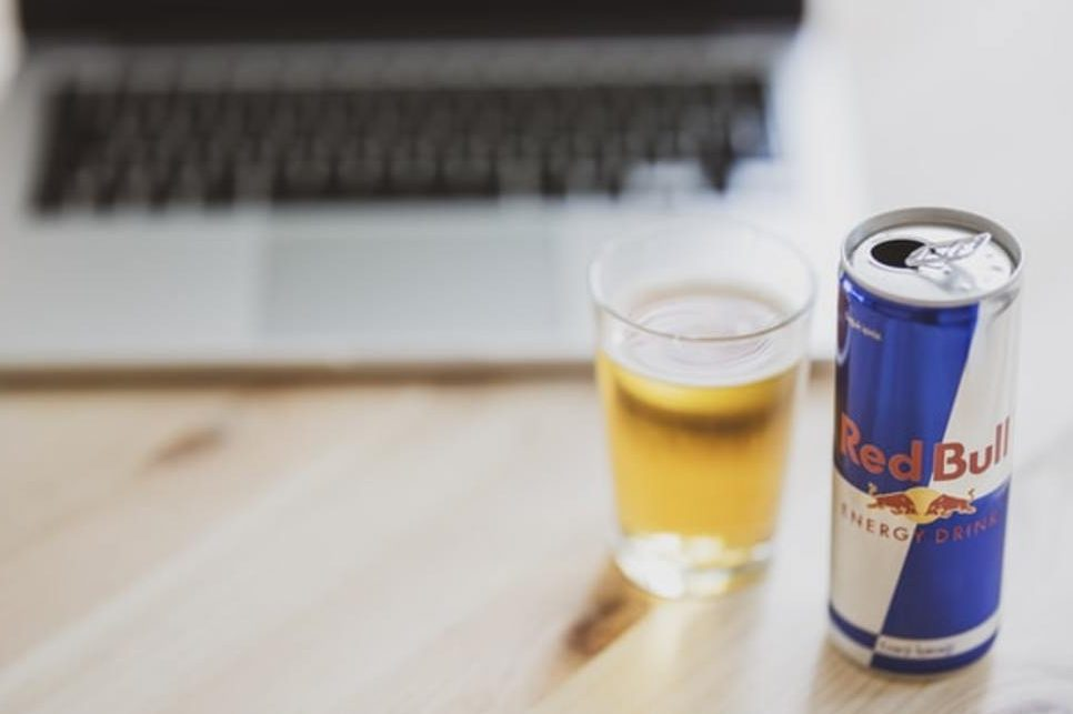 Red Bull in front of a laptop.