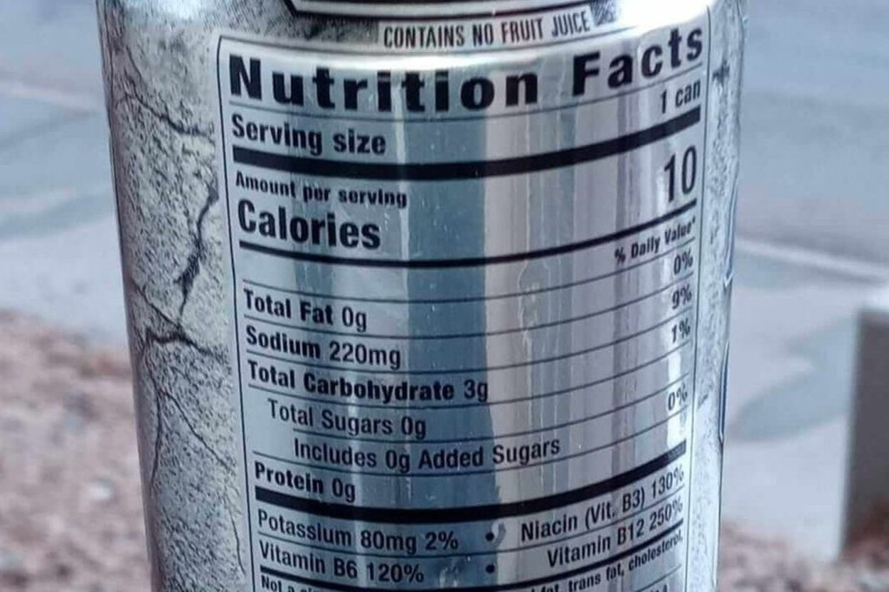 Reign energy drinks nutrition facts printed on the side of the can.