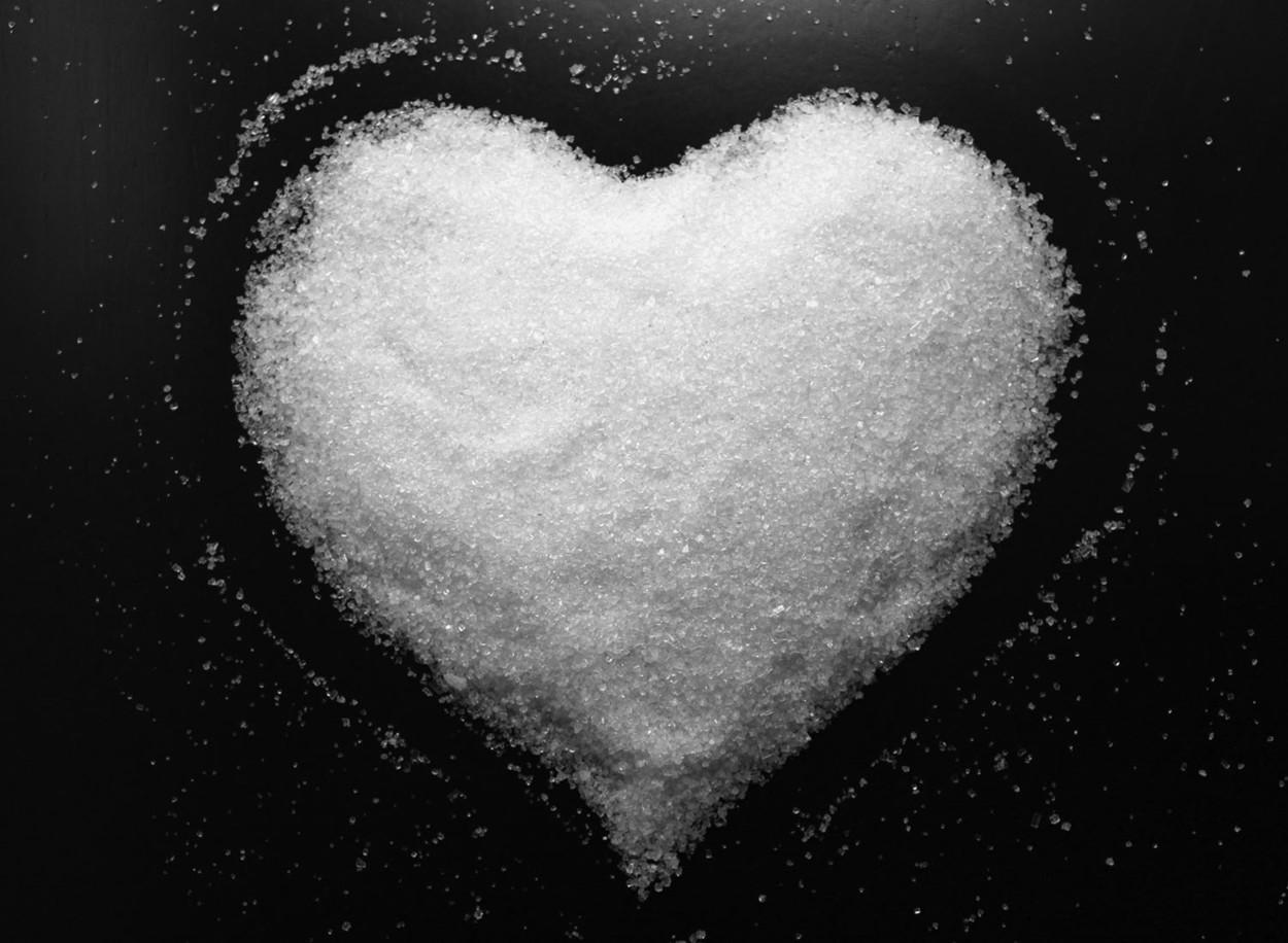 Heart-shaped pile of sugar.
