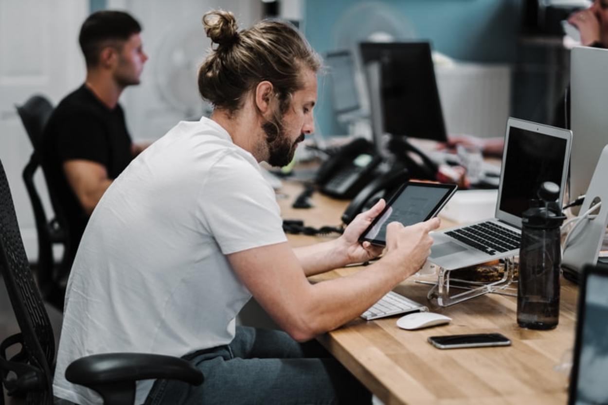 A man looking at his tablet.