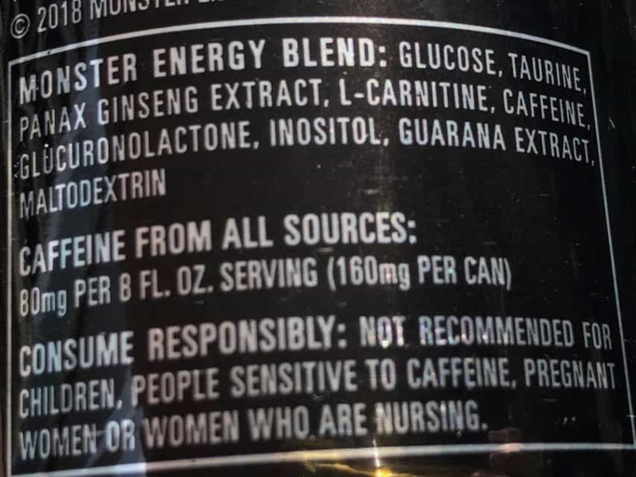 Caffeine warning behind a can of Monster Energy drink