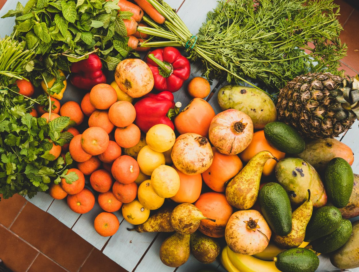 A pile of colorful fruits and vegetables.