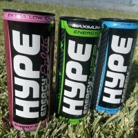 Hype energy drink cans on the grass