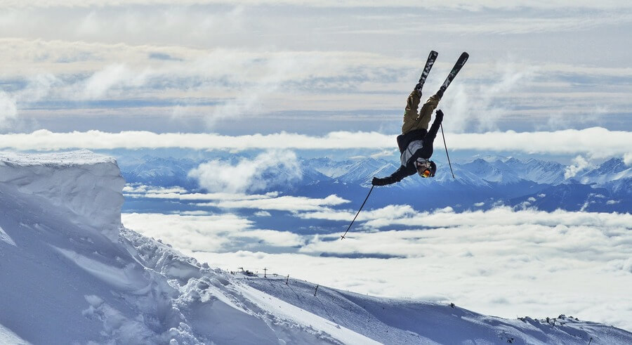 Man doing snow skiing tricks